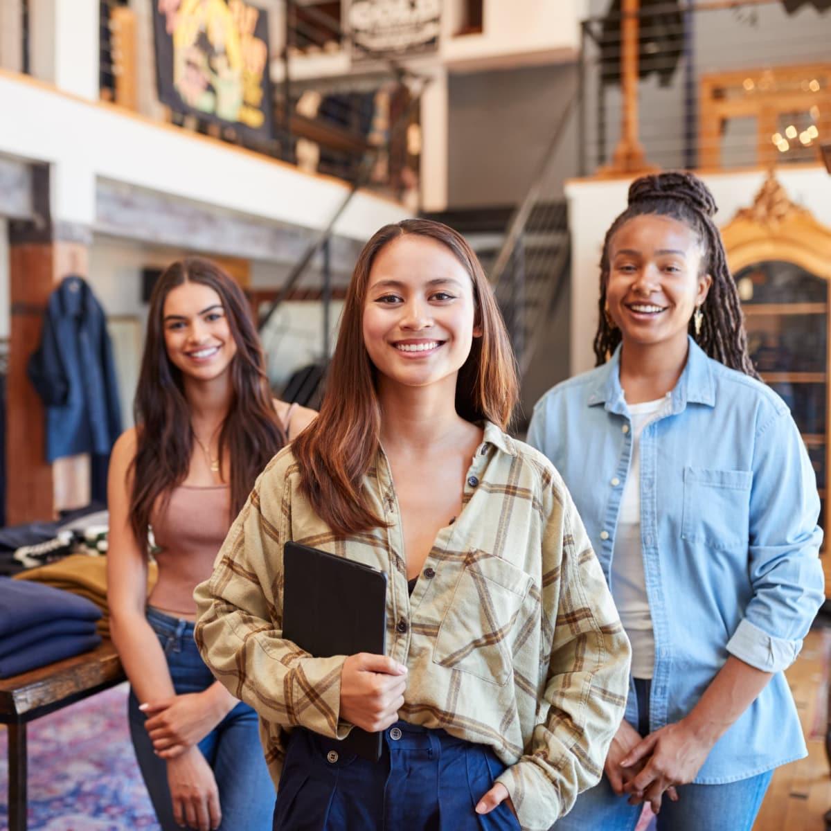 three women working in clothing store